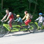 an amazingly long bike with an attachment bike for two children with an electric motor